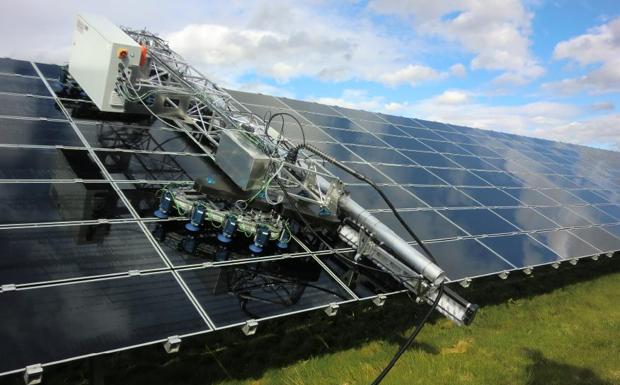 Cleaning of utility scale PV plants by robot